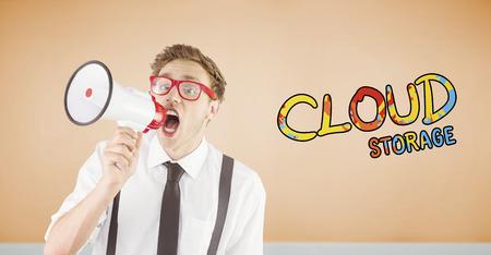 geeky: Geeky businessman shouting through megaphone against room with wooden floor