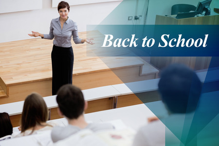 lecturing hall: The word back to school against teacher standing talking to the students