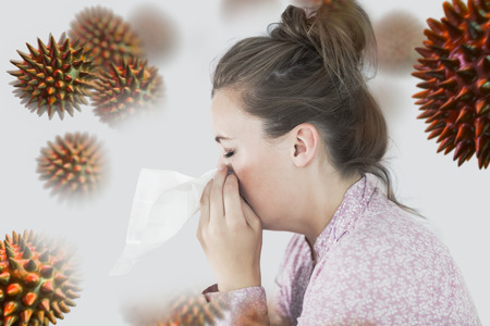 bloodstream: Young woman blowing her nose against virus Stock Photo