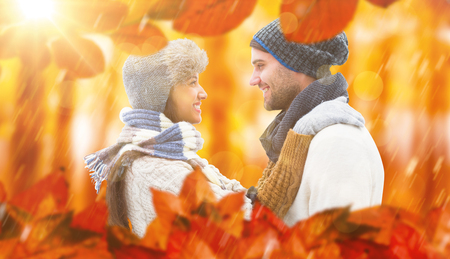 love couple: Young winter couple against view of a forest in the mist Stock Photo