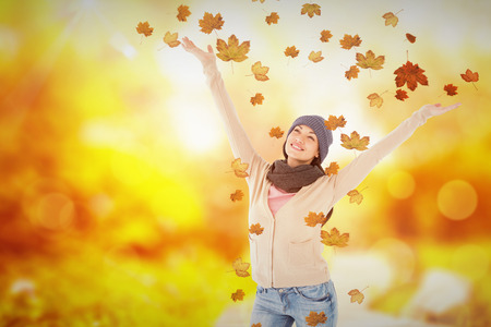 human arm: Smiling brunette standing arms open against autumn scene
