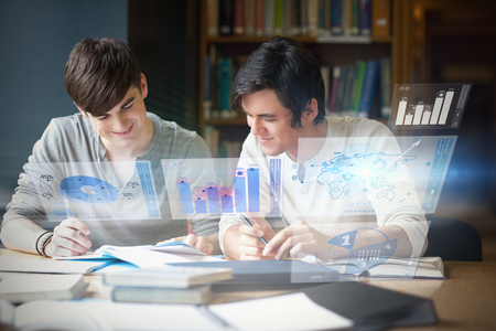 man holding transparent: Illustration of graphs and pie charts against students preparing an essay Stock Photo