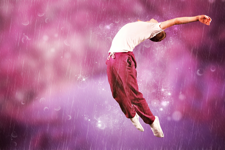 breakdancer: Cool break dancer against purple coloured forest Stock Photo