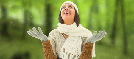 warm clothing: Brunette in warm clothing against trees in the autumnal forest Stock Photo