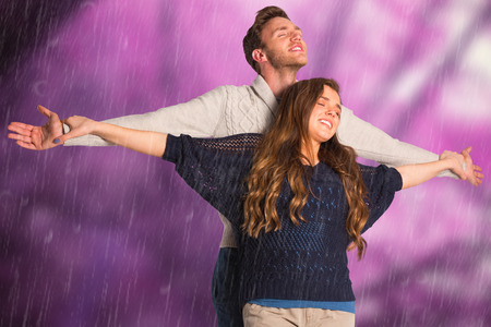 arms out: Romantic young couple with arms out against colourful forest