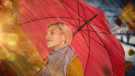 shivering: Happy woman keeping dry against autumn turning to winter