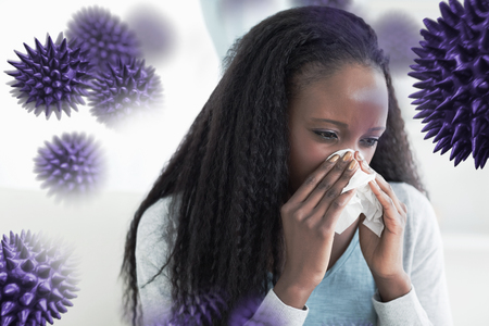 shiver: Close up of woman blowing her nose against virus Stock Photo