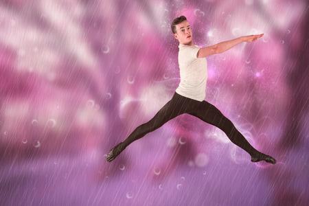 male ballet dancer: Male ballet dancer jumping against purple forest Stock Photo