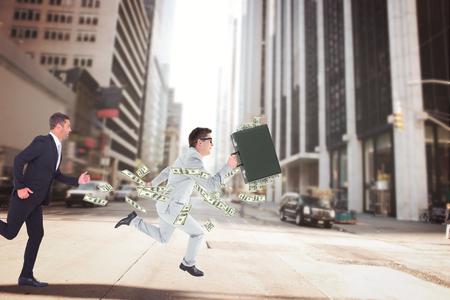 running businessman: Running businessman against new york street