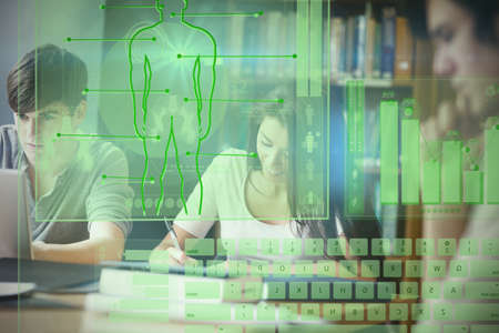 essay: Illustration of human body with bar graph and keyboard against students working on an essay Stock Photo