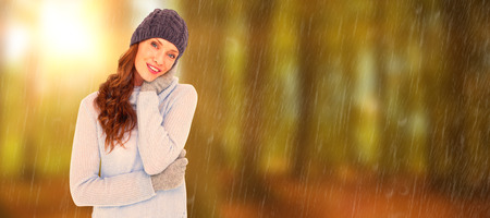 warm clothing: Pretty redhead in warm clothing against autumn scene