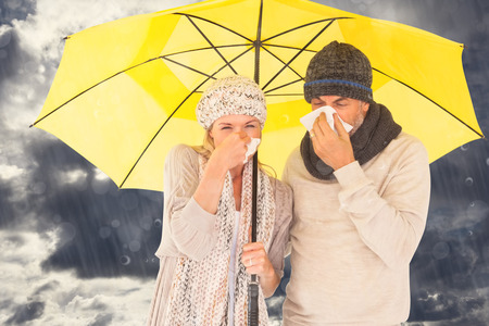 realtionship: Couple sneezing in tissue while standing under umbrella against blue sky with white clouds