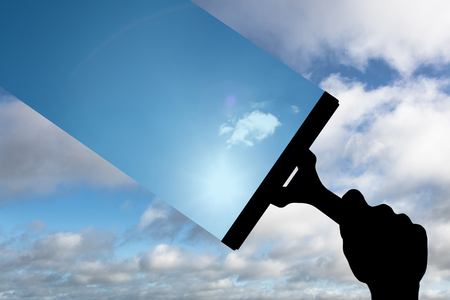 wiper: Hand using wiper against blue sky with clouds