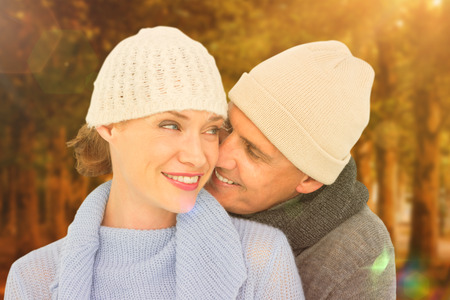 warm clothing: Casual couple in warm clothing against autumn scene