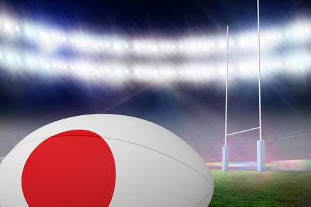 rugby ball: Japanese flag rugby ball against rugby pitch