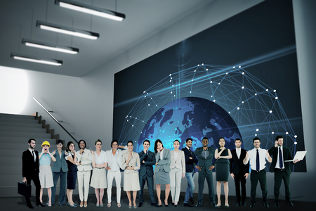 businessman carrying a globe: Multiethnic business people standing side by side against grey room