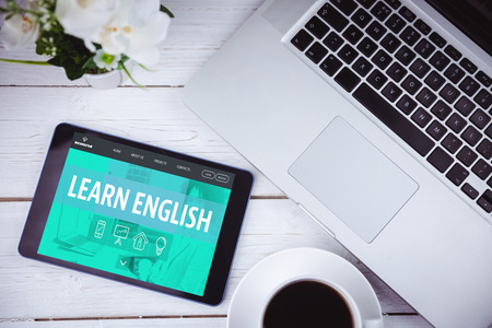 learn english: Learn english interface against tablet on desk