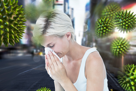 bloodstream: Sick woman blowing her nose against blurry new york street Stock Photo