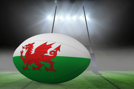 Welsh flag rugby ball against rugby pitch