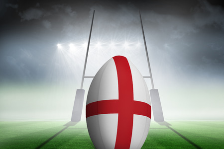 rugby ball: England flag rugby ball against rugby pitch
