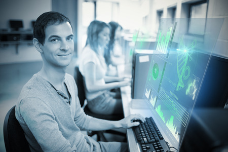 Digital representation of pie chart against smiling male student posing with a computer Stock Photo