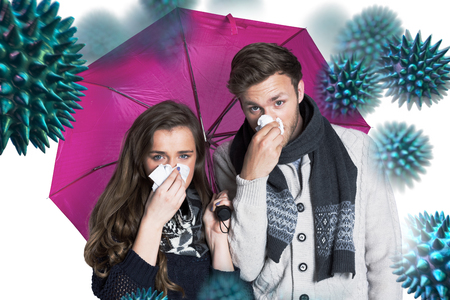 holding nose: Couple blowing nose while holding umbrella against virus Stock Photo