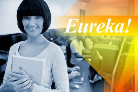 eureka: The word eureka! against teacher with tablet pc Stock Photo