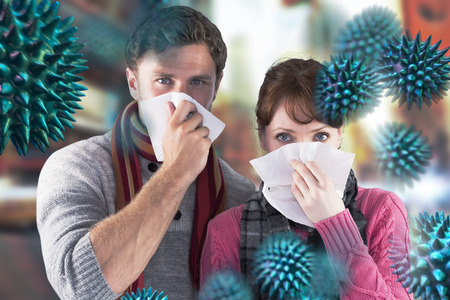 bloodstream: Couple blowing noses into tissues against blurred new york street