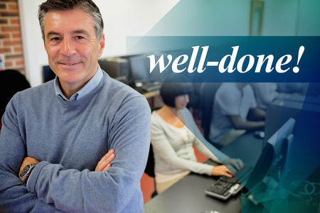 man studying: The word well-done! against teacher smiling at top of computer class Stock Photo