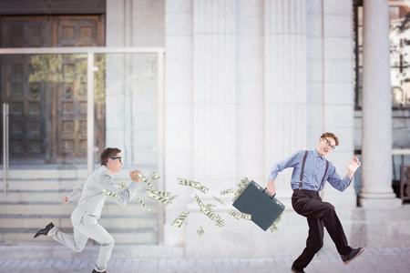 running businessman: Composite image of running businessman Stock Photo
