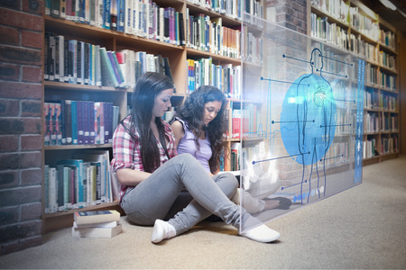 bookshop: Digital representation of a human body against female students with a book