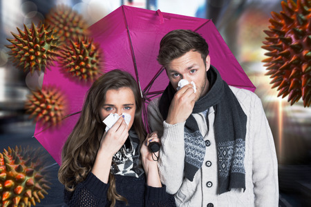 blowing nose: Couple blowing nose while holding umbrella against blurry new york street Stock Photo