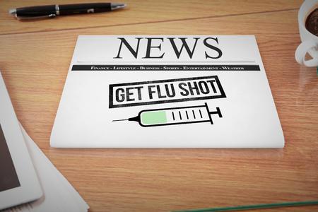 headline: newspaper with flu headline against overhead of office desk