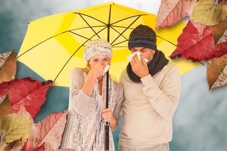 realtionship: Couple sneezing in tissue while standing under umbrella against low angle view of sky Stock Photo