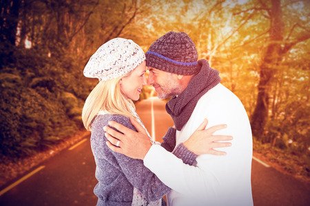 touching noses: Smiling cute couple romancing over white background against country road