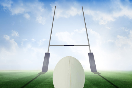 pitch: Close-up of rugby ball against rugby pitch Stock Photo