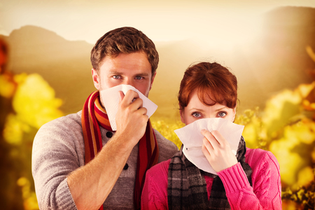 red nose: Couple blowing noses into tissues against greenness field of grapevine Stock Photo