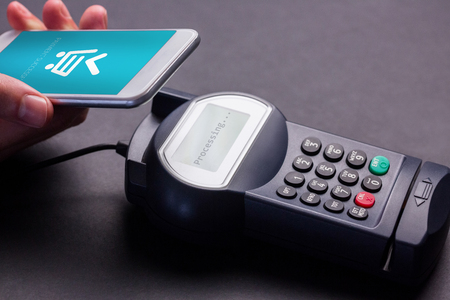 retail equipment: Payment successful on screen against man using smartphone to express pay