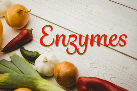 enzymes: enzymes against various vegetables on wooden table Stock Photo