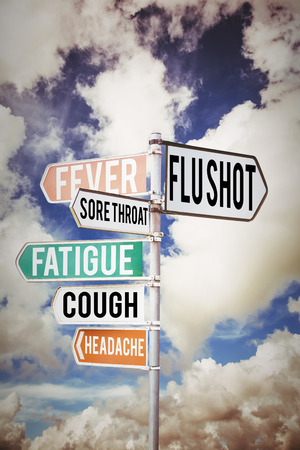 flu vaccine: flu shots against multi colored sign posts against cloudy sky Stock Photo