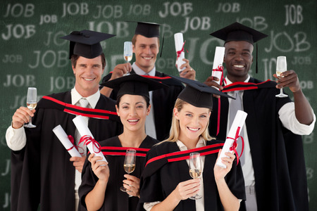 graduating: Group of people Graduating from College against green chalkboard Stock Photo