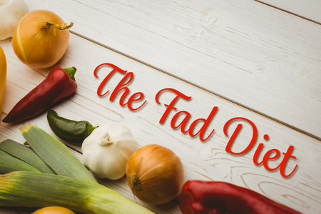 fad: the fad diet against various vegetables on wooden table Stock Photo