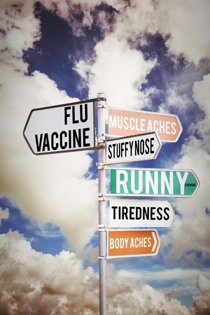 flu shot: flu shots against multi colored sign posts against cloudy sky Stock Photo
