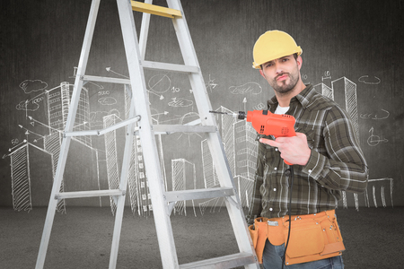 power drill: Portrait of handyman with power drill standing by ladder against hand drawn city plan