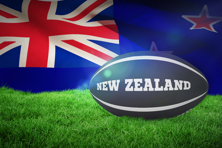 rugby: New Zealand rugby ball against new zealand flag against white background