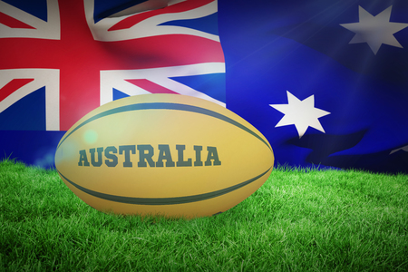 world flag: Australia rugby ball against close-up of australian flag