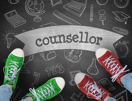 health education: The word counsellor and casual shoes against black background Stock Photo