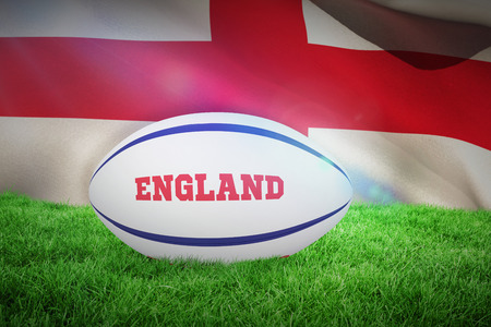 rugby field: England rugby ball against england flag against white background