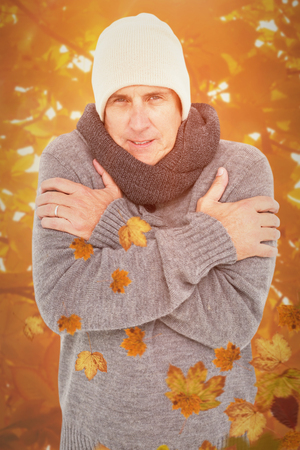 shivering: Casual man shivering in warm clothing against autumn scene
