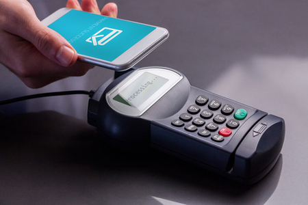 nfc: Mobile screen showing payment successful  against man using smartphone to express pay